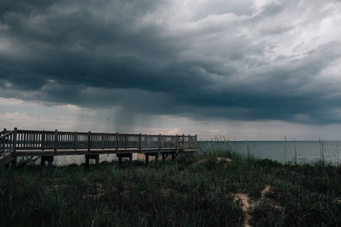 boardwalk and beach access in virginia beach with storm clouds