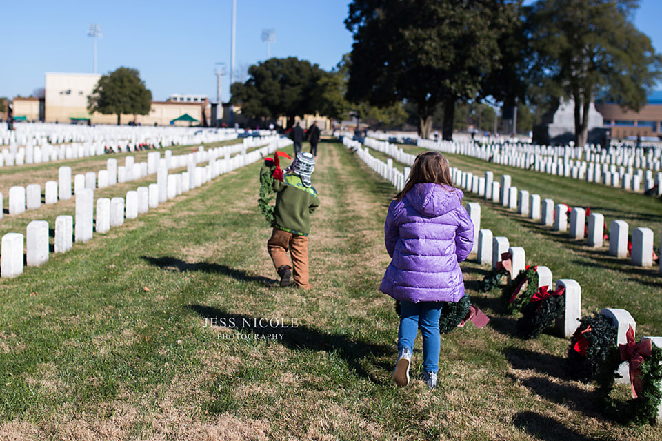 children placing wreaths at the national cemetery in hampton, va