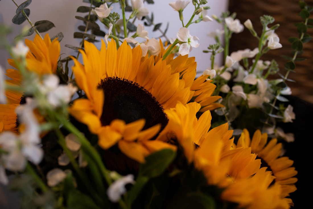 close up detail of bridal bouquet of sunflower blooms