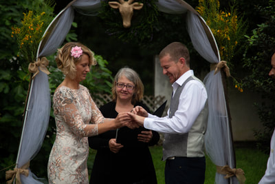 bride and groom exchange rings in an intimate ceremony
