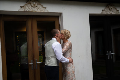 bride and groom kiss after intimate ceremony