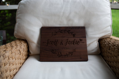 wooden sign with bride and grooms name engraved