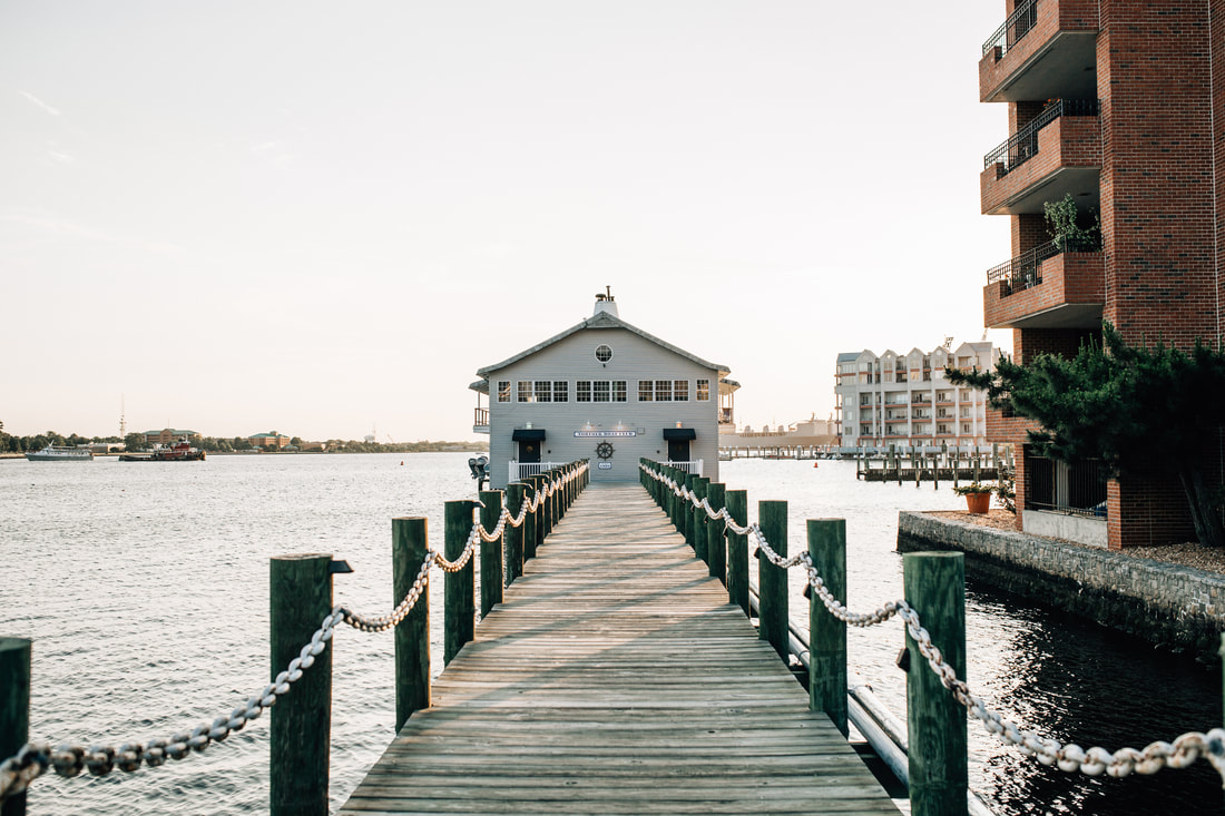 waterfront boat house and dock in downtown norfolk virginia at sunset