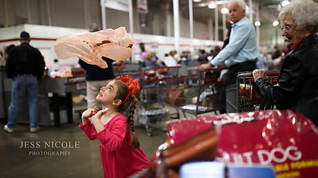 girl playing with bag at costco in Norfolk, Virginia